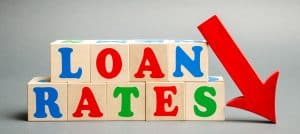Wooden blocks with the word loan rates and arrow down